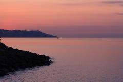Het overzees van de zonsondergang Stock Foto's