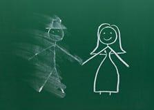 Het paar dat van het huwelijk op schoolbordscheiding trekt verdeelt bevlekt Royalty-vrije Stock Afbeelding