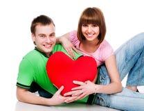 Het paar met een rood hoort Royalty-vrije Stock Foto's