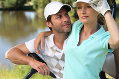 Het paar van de golfspeler Stock Fotografie