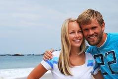 Het Paar van het strand Stock Afbeeldingen