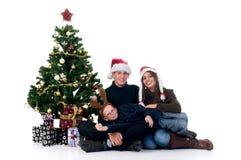 Het paar van Kerstmis met kind stock foto