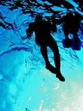 Het paar in water stock foto's
