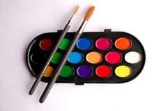 Het palet en de borstels van de kleur Stock Foto's