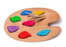 Het palet van de kunstenaar met kleuren en borstels Royalty-vrije Stock Foto
