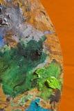 Het Palet van de schilder op sinaasappel Royalty-vrije Stock Afbeeldingen