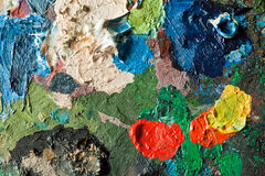 Het palet van kunstenaars met gemengde olieverf royalty-vrije stock afbeeldingen