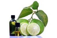 Het parfumflessen van de citroen stock afbeelding