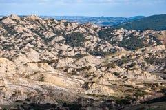 Het park van de Aliano-geulen, bergen van klei die het landschap van de Aliano-valleien omringen stock foto's