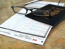 Het paspoort van Canada op verklaringskaart Stock Foto