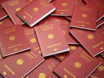 Het paspoortachtergrond van Duitsland Immigratie of reisconcept stapel Stock Foto