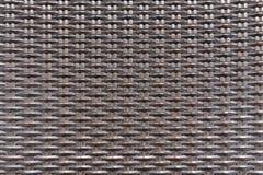 Het patroon naadloze van de weefsel plastic rieten rotan textuur als achtergrond Royalty-vrije Stock Foto's