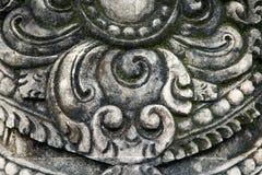 Het patroon op de steen is een close-up van een Balinese tempel Stock Foto