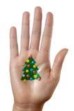 Het patroon van de kerstboom op een hand stock afbeelding
