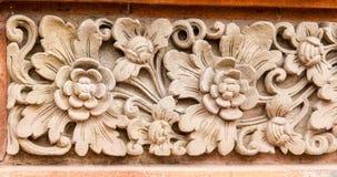 Het patroon van de steenbloem in tempel van Ubud Stock Foto