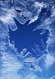 Het patroon van de vorst op een vensterglas Royalty-vrije Stock Afbeeldingen