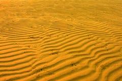Het patroon van het zandstrand Stock Foto's