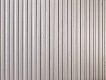 Het patroonachtergrond van het metaal met lijnen Royalty-vrije Stock Foto
