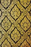 Het patroonmuurschilderingen van Thailand op deur boeddhistische tempels Royalty-vrije Stock Foto's