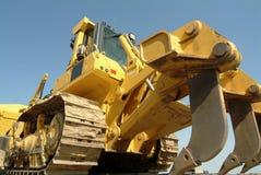 Het perspectief van de bulldozer in bouwwerf stock afbeeldingen