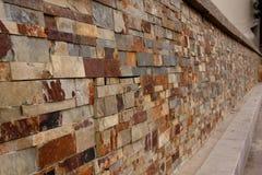 Het perspectief van de granietbakstenen muur Stock Fotografie