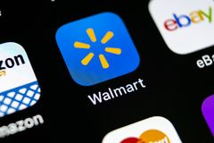 Het pictogram van de Walmarttoepassing op Apple-iPhone X het schermclose-up Walmartapp pictogram Walmart Com is multinationaal in Stock Afbeeldingen