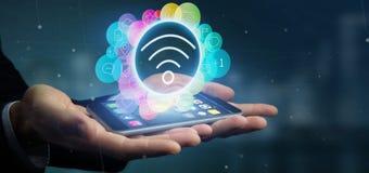 Het pictogram van Wifi van de zakenmanholding het omringen door sociale colorfull me Stock Foto's