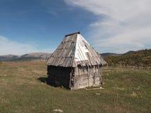 Het plattelandshuisje stock afbeeldingen