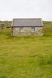 Het plattelandshuisje van de steen Stock Foto