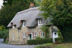 Het plattelandshuisje van het land stock afbeeldingen