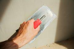 Het pleisteren van een muur Stock Fotografie