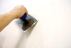 Het pleisteren van hulpmiddel Stock Foto