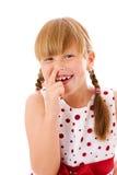 Het plukken van het meisje neus Stock Foto's