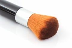 Het poederrouge van de make-upborstel stock fotografie