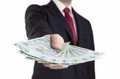 Het poetsmiddelgeld van de zakenmanholding Stock Fotografie