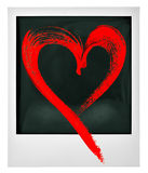 Het polaroid- onmiddellijke rode hart van het fotokader Stock Foto's