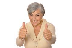 Het portret van bejaarde het tonen beduimelt omhoog royalty-vrije stock afbeelding
