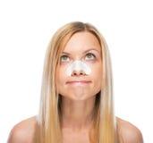 Het portret van betrokken tiener met verklaart stroken op neus stock foto's