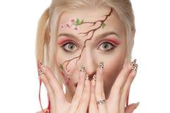 Het portret van de close-up van een meisje met gezicht-kunst Royalty-vrije Stock Afbeeldingen
