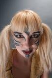 Het portret van de close-up van een meisje met gezichtsart. Royalty-vrije Stock Foto's