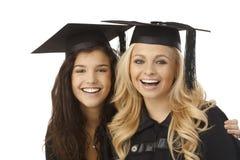 Het mooie gediplomeerden gelukkig glimlachen Royalty-vrije Stock Afbeeldingen