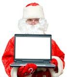 Het portret van de Kerstman met een notitieboekje. Stock Foto
