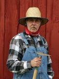Het portret van de landbouwer met schuurachtergrond Stock Foto's