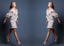 Het portret van de manierschoonheid van het jonge mooie vrouw springen over gr. Stock Afbeeldingen