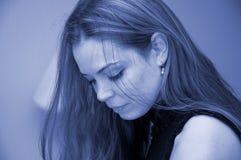 Het portret van de vrouw in blauw royalty-vrije stock foto's