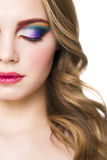 Het portret van een mooi jong blond model met helder maakt omhoog royalty-vrije stock afbeelding