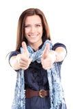 Het portret van een mooie jonge vrouw die duimen tonen ondertekent omhoog stock foto's