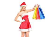 Het portret van een vrouw kleedde zich als Kerstman Stock Foto