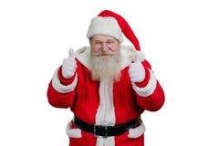 Het portret van Kerstman het geven beduimelt omhoog gebaar royalty-vrije stock afbeelding