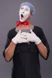 Het portret van mannetje bootst in rood hoofd en met wit na Royalty-vrije Stock Foto